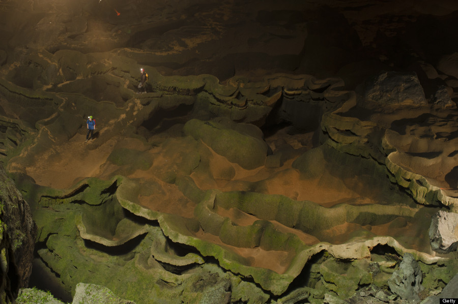 VIETNAM - MAY 02:  Hang Son Doong explorers navigate an algae-covered cavescape. Phong Nha Ke Bang National Park, Vietnam.  (Photo by Carsten Peter/National Geographic/Getty Images)