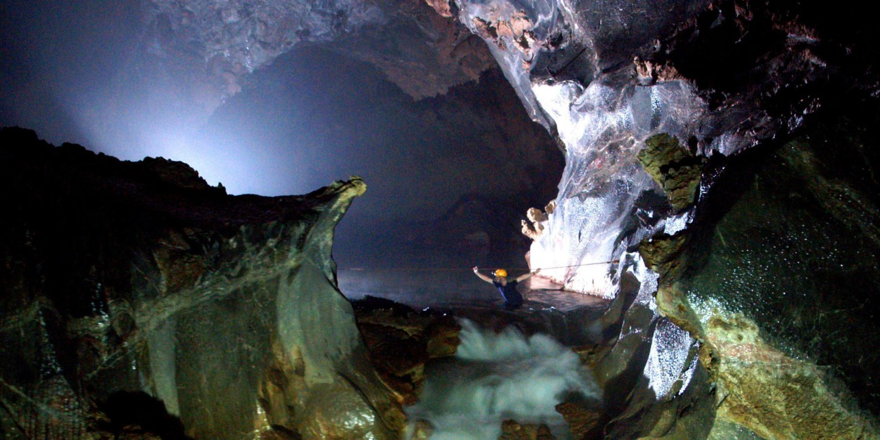 VIETNAM - UNDATED: ***EXCLUSIVE*** The British caving team crossing one of the underground rivers inside the Hang Son Doong cave in Ke Bang Massif, Vietnam, April 2009. A British Caving team believe they have discovered the largest sized cave passage in the world. Measuring 200 metres in height and 150 metres in width the new cave, called Hang Son Doong (Mountain River Cave), is 6.5 km long. Assisted by representatives of Hanoi University of Science the team explored the new cave for five days. The team spent six hours trekking through the jungle to reach the cave. Climbing down into a large chamber, they had to negotiate two underground rivers before reaching the main passage of the Hang Son Doong. The team will return to Vietnam later in the year to complete the expedition of the cave and conduct a full survey. (Photo by Joint British-Vietnamese Caving Expedition 2009 / Barcroft Media / Getty Images)