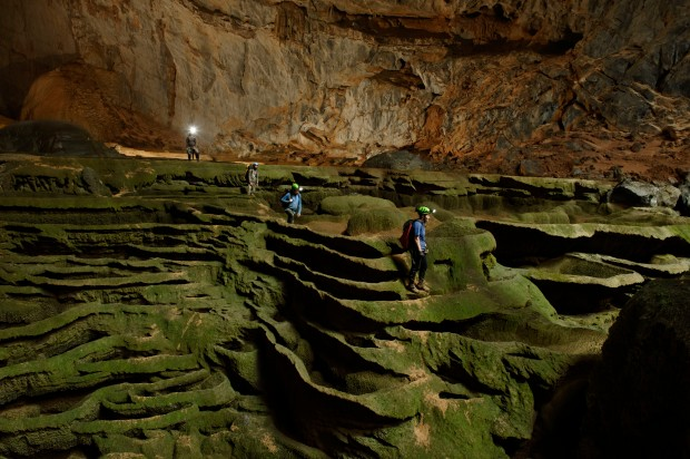 VIETNAM - MAY 02:  Hang Son Doong explorers navigate an algae-covered cavescape.  (Photo by Carsten Peter/National Geographic/Getty Images)